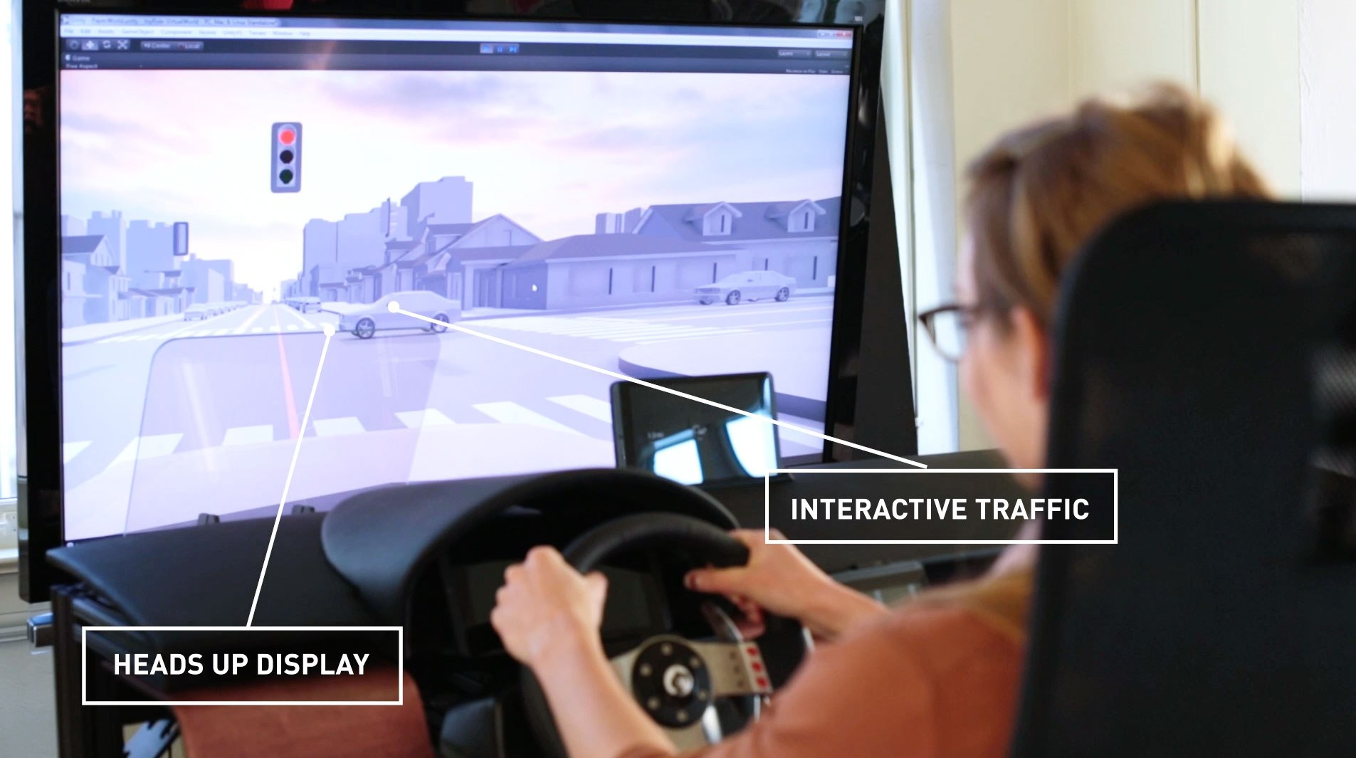 Blonde woman looking at heads up display on an autonomous car simulator